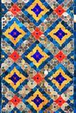 Teste padrão colorido cerâmico no templo da parede ilustração royalty free