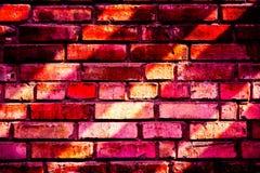 Teste padrão colorido da parede de tijolo, tijolos pintados como a textura urbana Fotografia de Stock Royalty Free