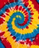 Teste padrão colorido do projeto da espiral do redemoinho da tintura do laço foto de stock