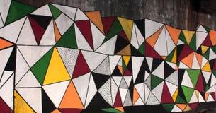 Teste padrão colorido dos triângulos do grunge dos grafittis Foto de Stock