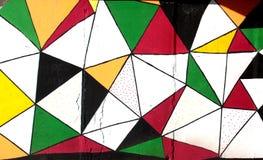 Teste padrão colorido dos triângulos do grunge dos grafittis Imagens de Stock Royalty Free