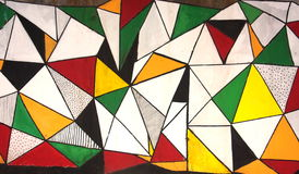 Teste padrão colorido dos triângulos do grunge dos grafittis Imagem de Stock Royalty Free