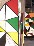 Teste padrão colorido dos triângulos do grunge dos grafittis Fotografia de Stock
