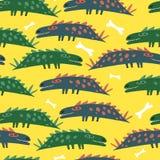 Teste padrão com amarelo dos dinos Fotografia de Stock