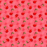 Teste padrão com cerejas em um fundo cor-de-rosa Foto de Stock
