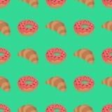 Teste padrão com croissant e filhós Imagem de Stock