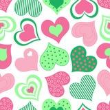 Teste padrão cor-de-rosa e verde dos corações Fotos de Stock