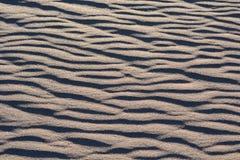 Teste padrão da areia do fundo Fotos de Stock Royalty Free