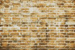 Teste padrão da estrutura velha alaranjada do fundo do tijolo da parede imagem de stock royalty free