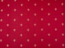 Teste padr?o da flor de lis pintado em uma parede vermelha Vintage vermelho e amarelo vinous luxuoso cl?ssico ilustração do vetor