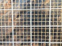 Teste padrão da malha do metal do close up imagem de stock