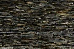 Teste padrão da superfície decorativa da parede de pedra da ardósia fotografia de stock royalty free