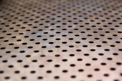 Teste padrão da textura do metal com furos Imagem de Stock Royalty Free