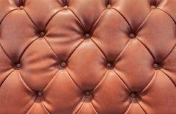 Teste padrão da textura do sofá marrom do couro do vintage Fotos de Stock Royalty Free