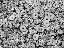Teste padrão das porcas de parafuso como o fundo industrial abstrato Fotografia de Stock