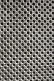 Teste padrão de furos do muro de cimento imagem de stock royalty free