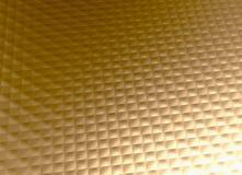 Teste padrão de grade dourado do fundo do metal do ouro Foto de Stock Royalty Free