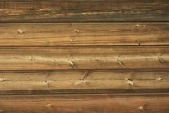 Teste padrão de madeira da textura da parede do celeiro do marrom avermelhado Fotografia de Stock Royalty Free