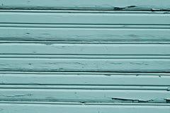 Teste padrão de madeira sujo ciano da parede imagem de stock
