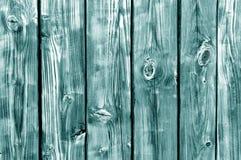 Teste padrão de madeira tonificado ciano da cerca foto de stock