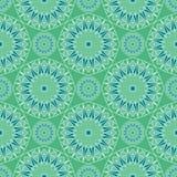 Teste padrão de mosaico de repetição azul e verde do caleidoscópio Foto de Stock