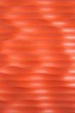 Teste padrão de ondas vermelhas de uma parede Imagens de Stock Royalty Free