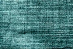 Teste padrão de pano das calças de brim no tom ciano imagem de stock royalty free