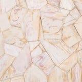 Teste padrão de pedra de superfície do close up do fundo de pedra marrom da textura da parede de tijolos no tom do vintage Imagem de Stock Royalty Free