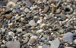 Teste padrão de pedra liso da tampa de pedras do seixo Imagem de Stock Royalty Free