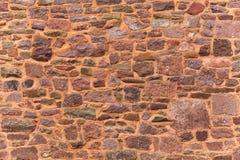 Teste padrão decorativo do fundo vermelho antigo da parede de pedra, textura parede aleatória da rocha do tamanho imagens de stock royalty free
