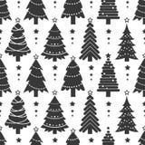 Teste padrão do inverno com as árvores de Natal pretas Foto de Stock Royalty Free