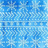 Teste padrão do inverno da aquarela com flocos de neve em um fundo azul Imagem de Stock