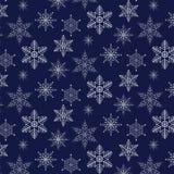 Teste padrão do Natal com os flocos de neve decorativos no fundo azul Imagem de Stock