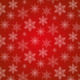 Teste padrão do Natal com os flocos de neve decorativos no fundo vermelho Foto de Stock