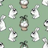 Teste padrão dos coelhos e das cestas da Páscoa Fotos de Stock Royalty Free
