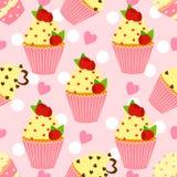 Teste padrão dos doces com queque e coração Imagens de Stock