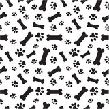 Teste padrão dos ossos e das patas de cão fotografia de stock