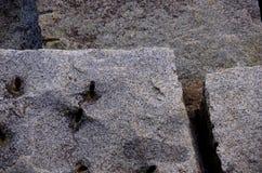 Teste padrão geométrico de blocos quarried do granito em Ogden Point Breakwater, Victoria, BC fotos de stock royalty free