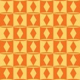 Teste padrão geométrico sem emenda alaranjado amarelo com rombo e quadrados Imagens de Stock Royalty Free