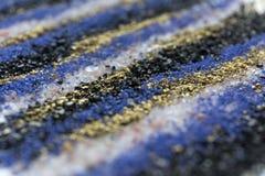 Teste padrão mergulhado da areia do borrão Fundo de mármore do estilo Textura defocused do pó do azul e do ouro fotografia de stock