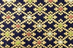 Teste padrão na textura tailandesa de pano Imagem de Stock