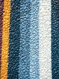 Teste padrão pintado colorido da decoração da parede da rocha imagens de stock royalty free