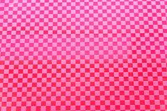 Teste padrão plástico vermelho como o fundo Fotografia de Stock