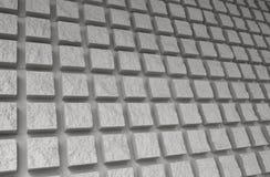 Teste padrão quadrado expulso da parede de tijolo foto de stock