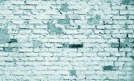 Teste padrão resistido velho da parede de tijolo em ciano tonificado foto de stock