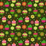Teste padrão sem emenda bonito com os queques no fundo verde ilustração royalty free