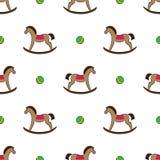 Teste padrão sem emenda com balançar-cavalos e bolas Imagem de Stock Royalty Free