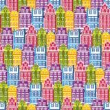 Teste padrão sem emenda com casas Telha pouco fundo da cor pastel da cidade Textura do papel de envolvimento com construções mult ilustração stock