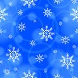 Teste padrão sem emenda com flocos de neve e teste padrão abstrato em um fundo azul Imagens de Stock Royalty Free