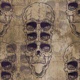 Teste padrão sem emenda com o crânio no fundo do grunge Imagens de Stock Royalty Free